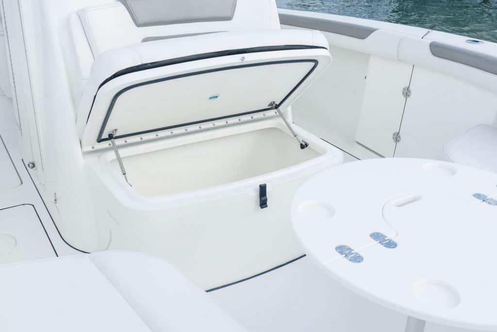 Double-wide bucket seat with armrests forward of the console with integrated cup holdersand storage