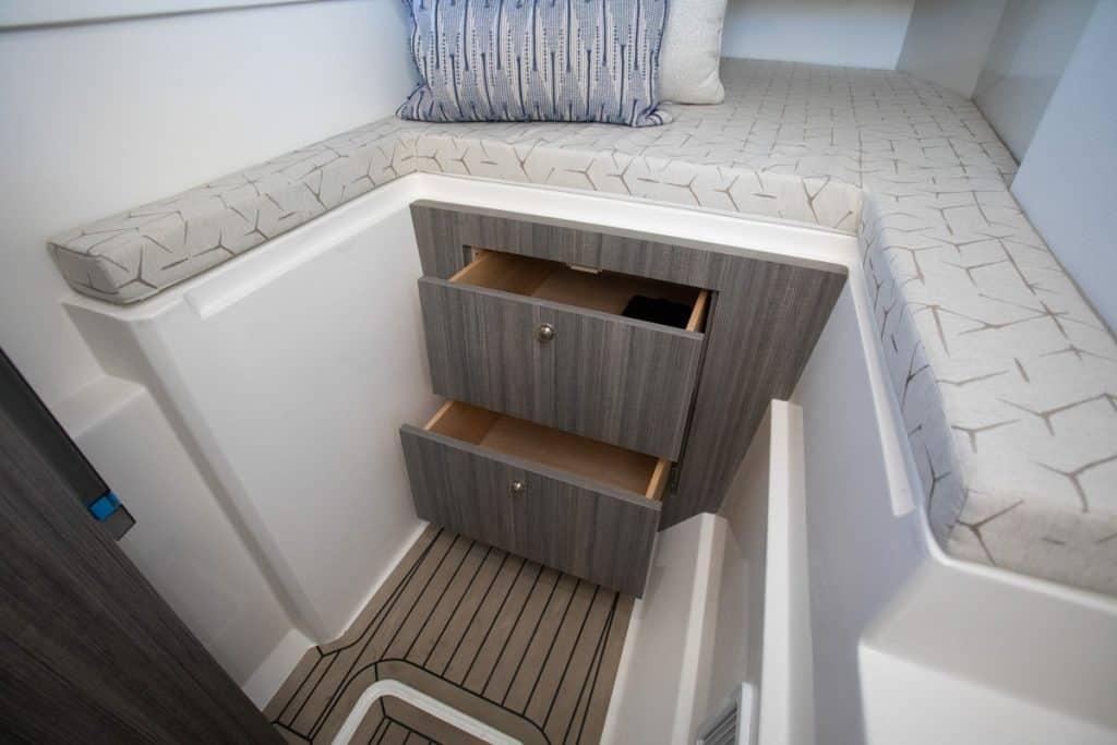 Bulk storage drawers under berth